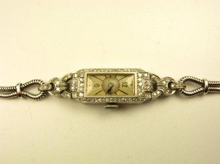 Platin Uhr mit Diamanten und Weißgoldarmband