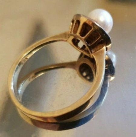Wert eines 585 Goldring mit Perle und 6 roten Steinen?