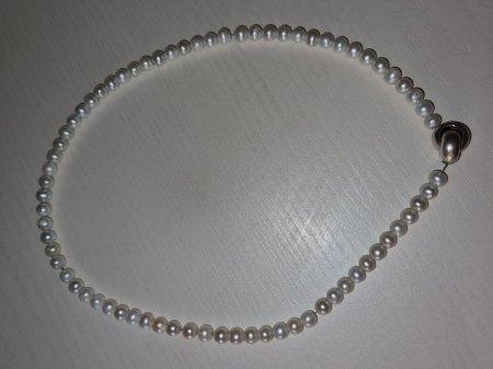 Perlenkette Verschluss Bedeutung